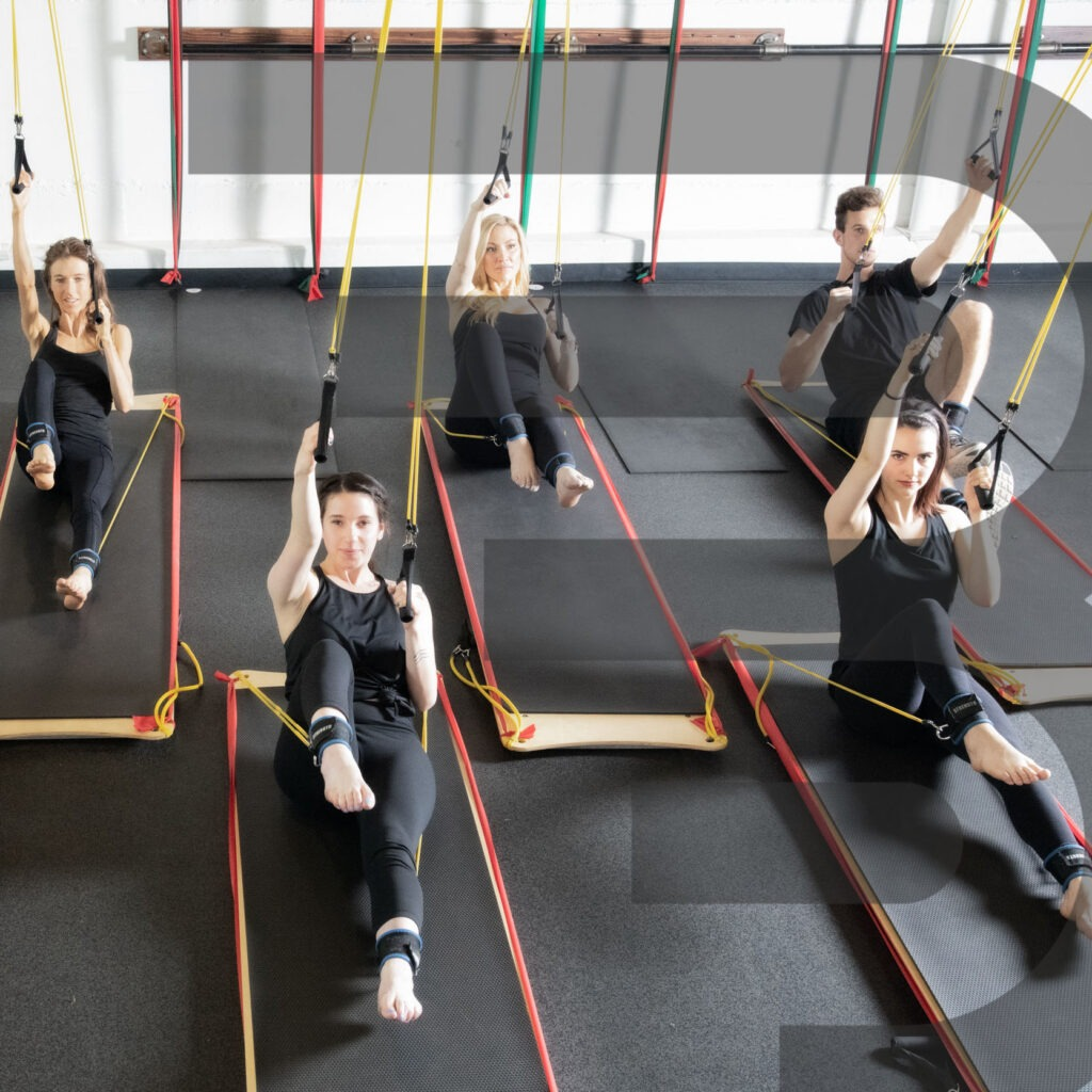 people working out using the BOARD30 system wearing all black